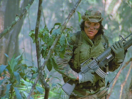 Predator movie Billy showing two guns together and SPI attached to a Moss 500 shotgun