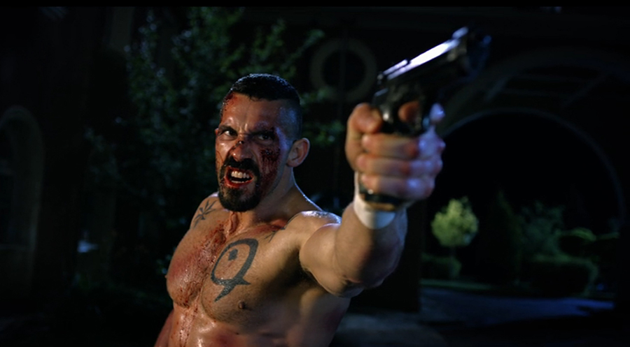 Scott Adkins as Boyka with a gun in Boyka: Undisputed