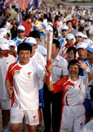 Jackie Chan carrying Olympic Torch