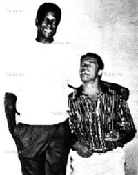 Kevin Peter Hall and Arnold Schwarzenegger