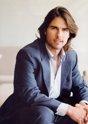 Tom Cruise with long hair in a blue suit