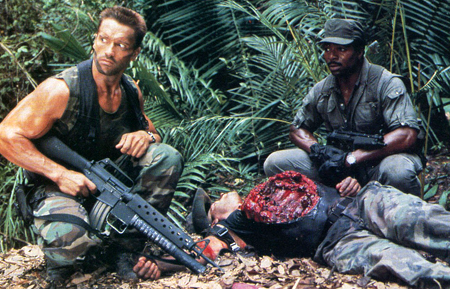 Predator movie Dutch and Dillon examine Blain's body and the cauterized wound