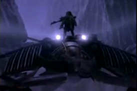The Chronicles of Riddick with Riddick standing on top of the moving Merc Spaceship