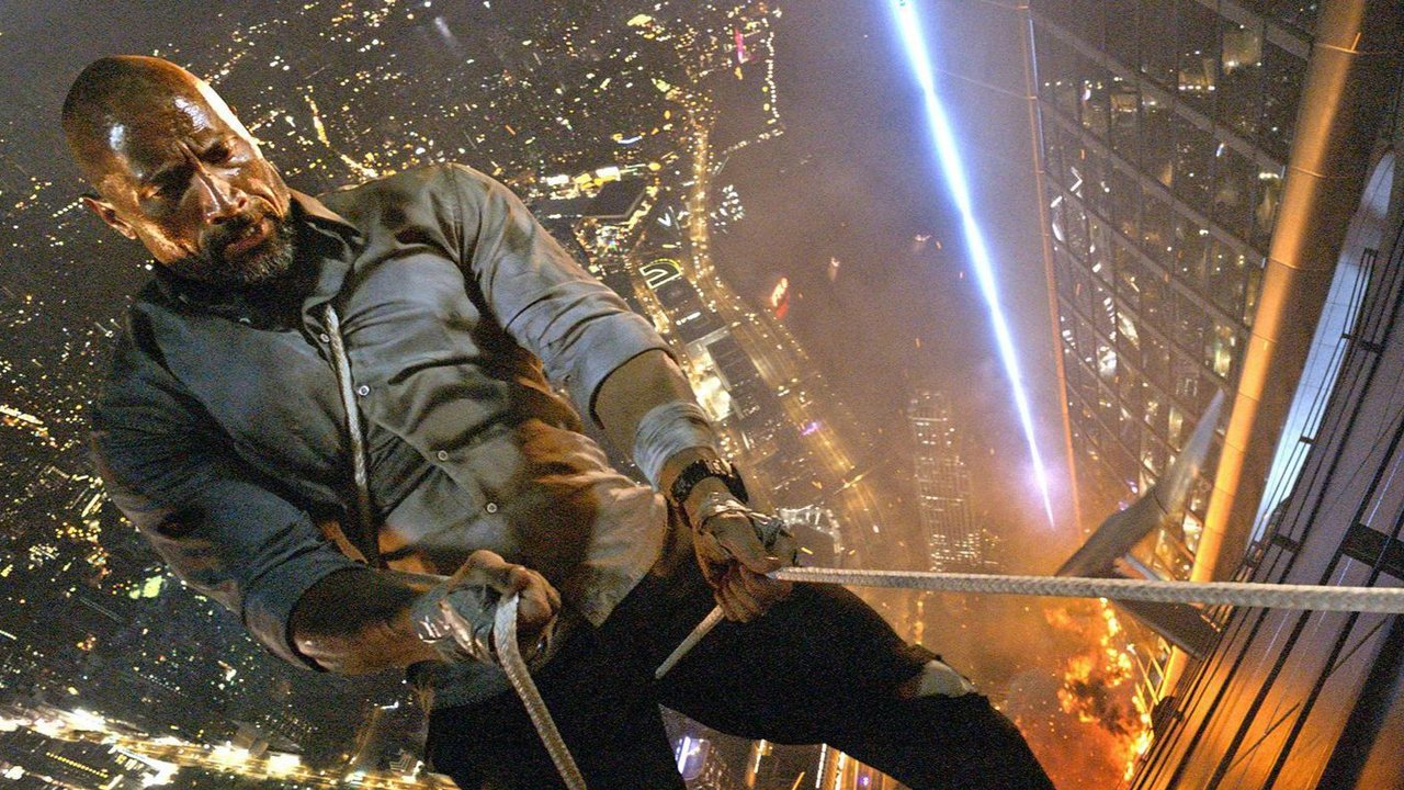 Dwayne Johnson repels down the side of the Pearl highrise in Skyscraper
