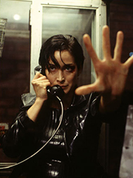 Trinity in the phone booth in The Matrix