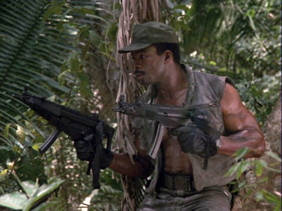 Predator movie Dillon with two guns at the ready