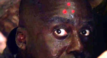 Predator movie Mac with the three-red-dots Predator target on his forehead