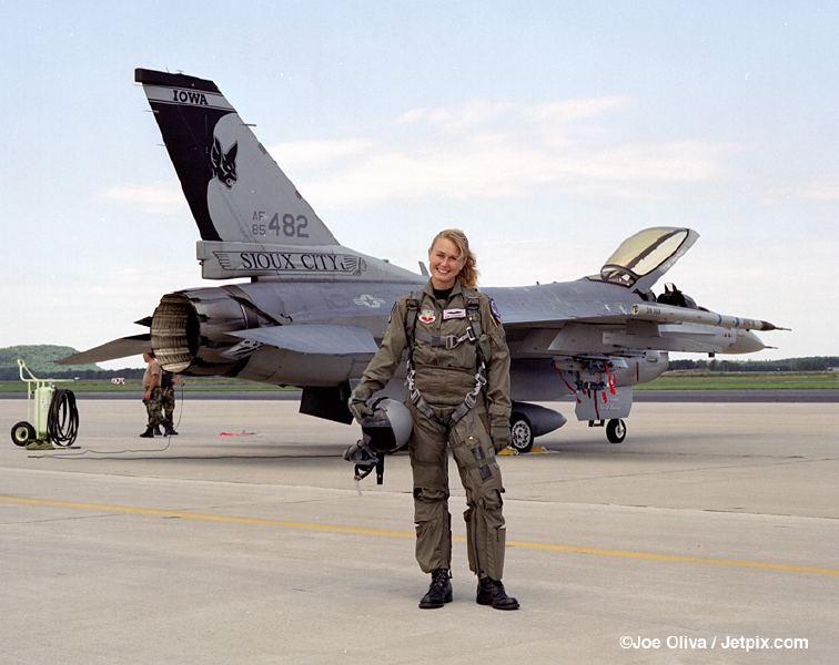 female fighter pilot in full gear